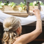 Cabin Wedding - Bride Reaches for Rings