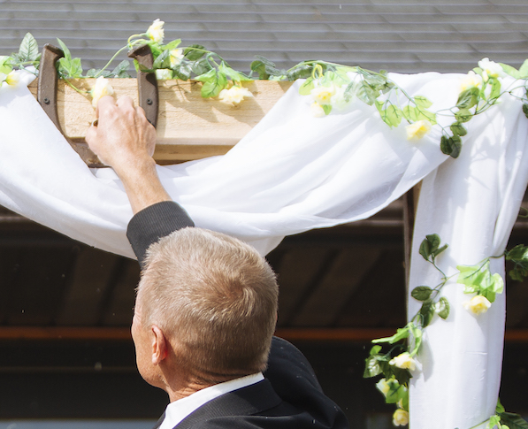 Cabin Wedding - Groom Reaches for Ring